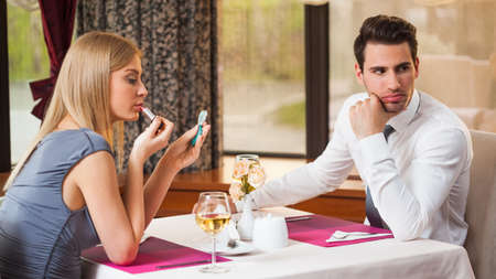 first date: Young couple is getting bored and on first date