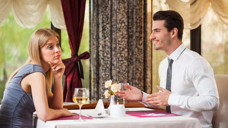 Woman is getting bored on first date photo
