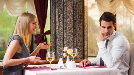 Man is getting bored on first date