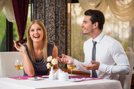Happy couple having great time at the restaurant Stock Photo
