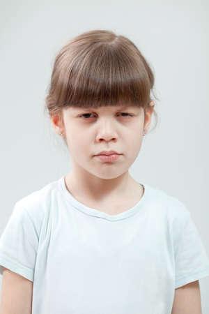 age 5: Portrait of displeased child