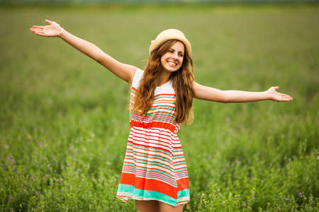teen girl brown hair: Portrait of happy girl in wheat field Stock Photo