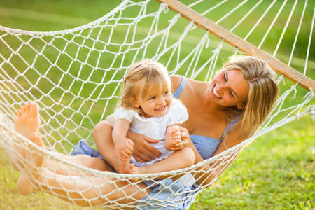 Happy mother and daughter in hammock photo