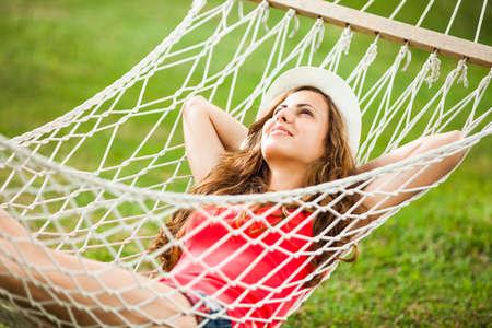 hammock: Happy girl resting in hammock Stock Photo