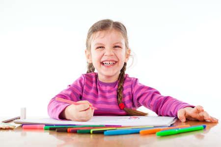 Happy child drawing Фото со стока