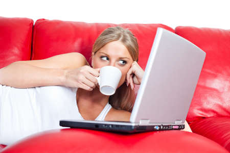 surfing the net: Girl surfing the net, drinking coffee