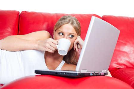 net surfing: Girl surfing the net, drinking coffee