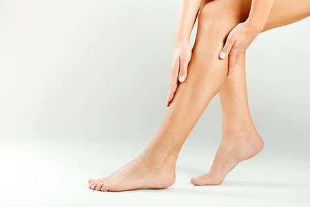 Beautiful female legs, smooth skin after waxing photo