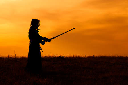 Silhouette of kendo fighter with shinai