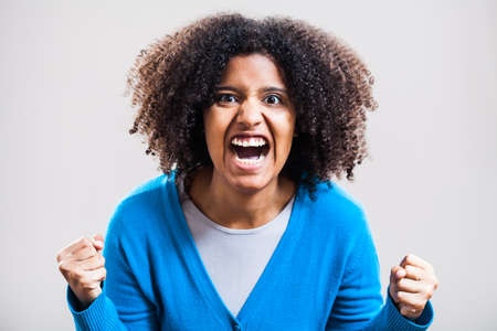 woman screaming: Portrait of furious woman screaming Stock Photo