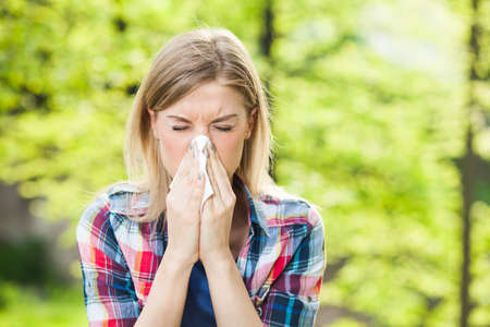 with pollen: Woman with allergy symptom blow her nose