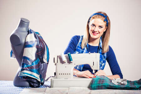 intentionally: Happy woman sews, intentionally toned