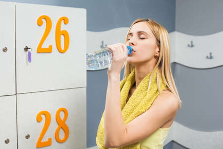 Girl drinking water before fitness training Stock Photo