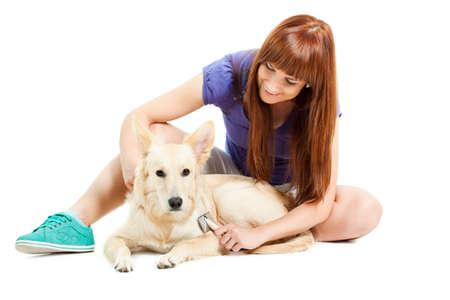 german shepard: Happy woman brushing her dog
