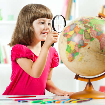 little girl: Little girl exploring planet earth and drawing in sketchbook Stock Photo
