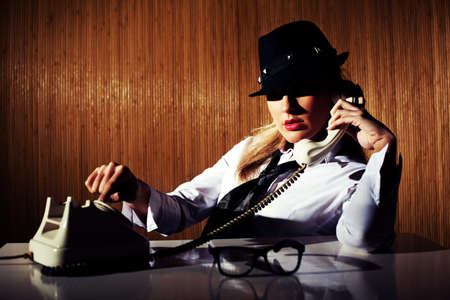 intentionally: Retro styled businesswoman talking on the phone intentionally toned. Stock Photo