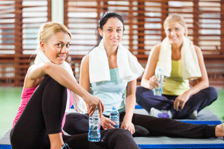 Happy women relaxing and talking after fitness training Фото со стока - 40337863