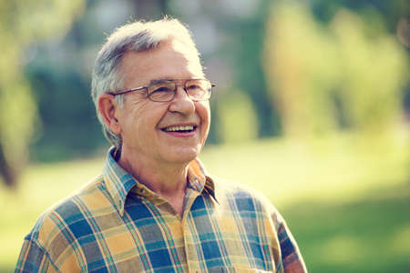 Portrait of happy senior man intentionally toned