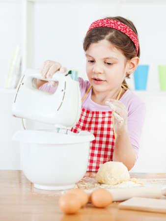 little dough: Little girl making the dough