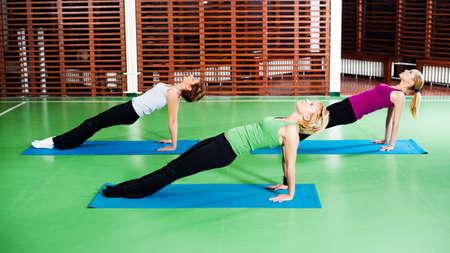 upward: Girls practicing yoga Purvottanasana  Upward plank pose Stock Photo