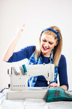 Tailor is angry because sewing machine is not working Фото со стока - 41182716