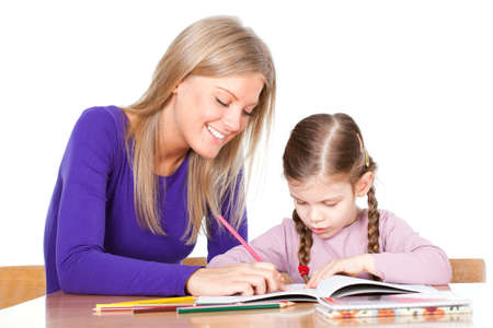 older woman smiling: Little girl learning to draw Stock Photo