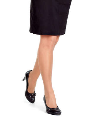 Attractive female legs isolated on white