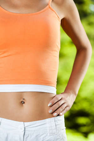 navel piercing: Perfectly shaped female stomach