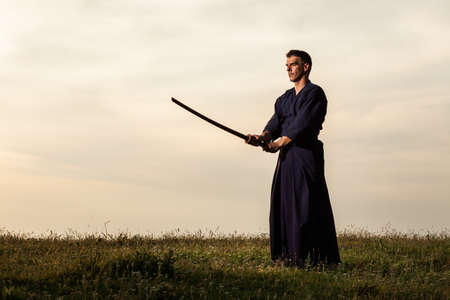 Kendo fighter holding bokuto.