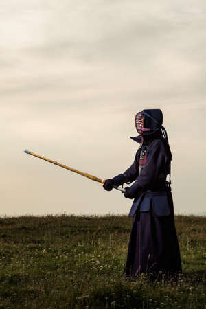 combative sport: Kendo fighter with shinai