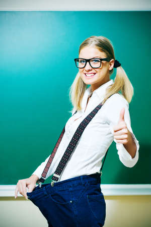 loosing: Nerdy student girl is loosing weight, intentionally toned.