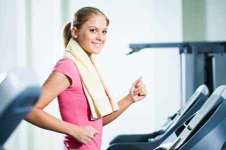 moving activity: Happy woman exercising in gym Stock Photo