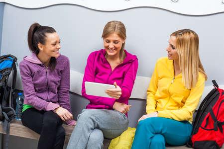 locker room: Young women in locker room before fitness training