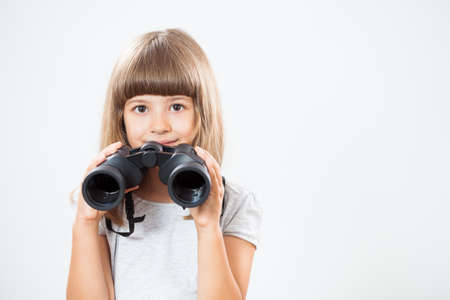 using binoculars: Little girl using binoculars
