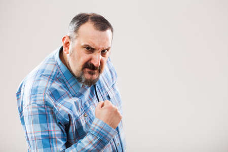 and the horizontal man: Portrait of angry man who threatens Stock Photo