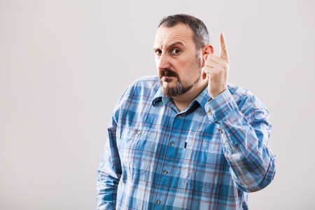 threatens: Portrait of angry man who threatens Stock Photo