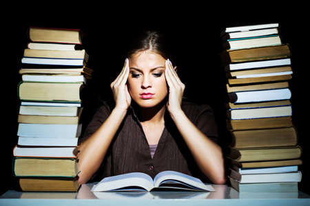 woman reading book: Worried student learning