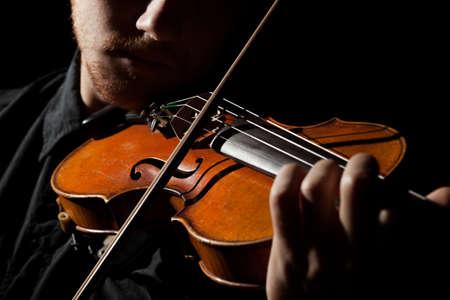 close portrait: Close-up photo of man playing violin
