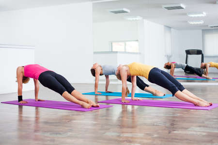 practicing: Three girls practicing yoga, Setuasana Bridge pose