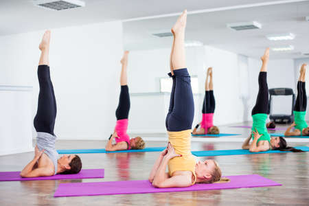 Girls practicing yoga, Yoga - Salamba Sarvangasana Supported shoulder stand