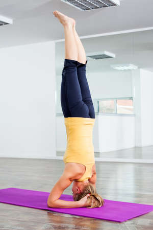 headstand: Girl practicing yoga, Yoga - Sirsasana Supported Headstand Pose