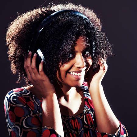 intentionally: Girl listening music on headphones, intentionally toned. Stock Photo