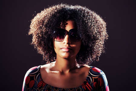 intentionally: Young woman wearing sunglasses, intentionally toned. Stock Photo
