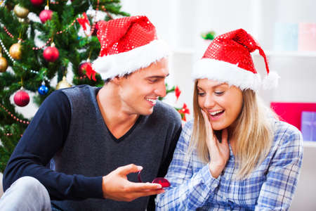 proposing: Man is proposing his girlfriend on christmas day