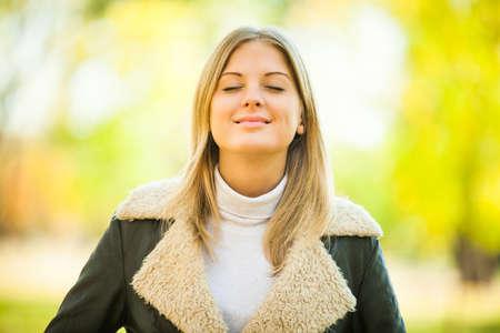 fresh air: Young happy woman enjoying fresh air in autumn Stock Photo