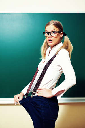 intentionally: Nerdy student girl loosing weight. Intentionally toned image. Stock Photo