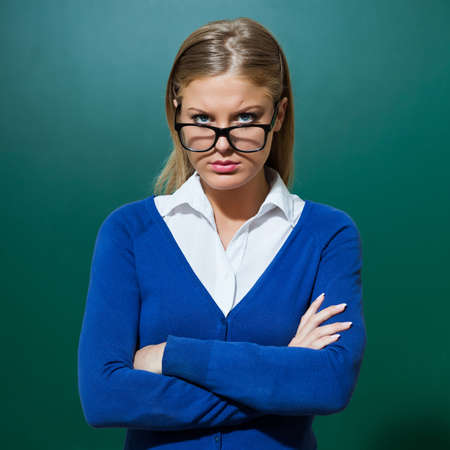 angry teacher: Portrait of young angry teacher Stock Photo