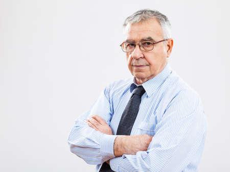 authoritative: Portrait of authoritative senior businessman