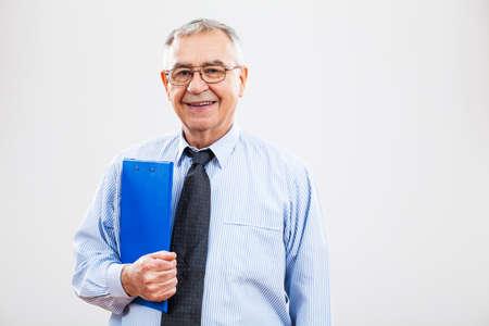 guy portrait: Portrait of successful senior businessman holding documents Stock Photo