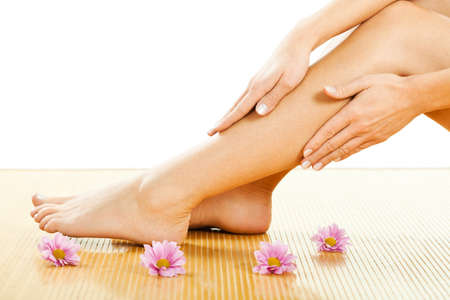 adult massage: Close up image of beautiful female legs with smooth skin after waxing.